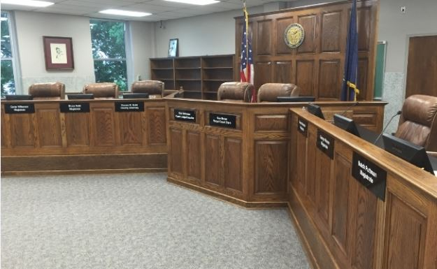 Fiscal Court Room With Wooden Seating Structure